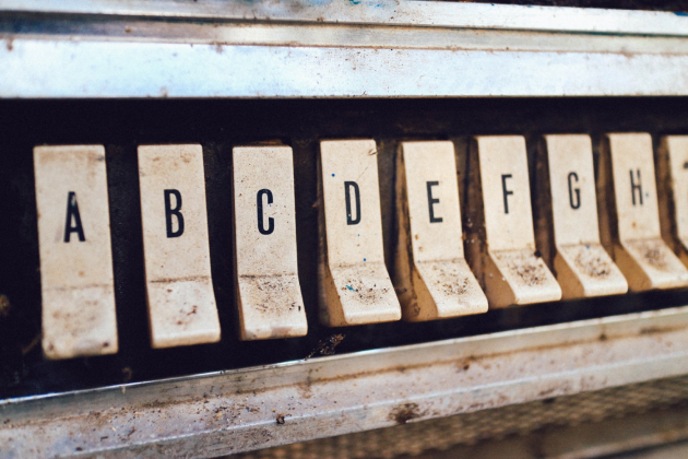 A dirty machine with letters A, B, C, D, E...