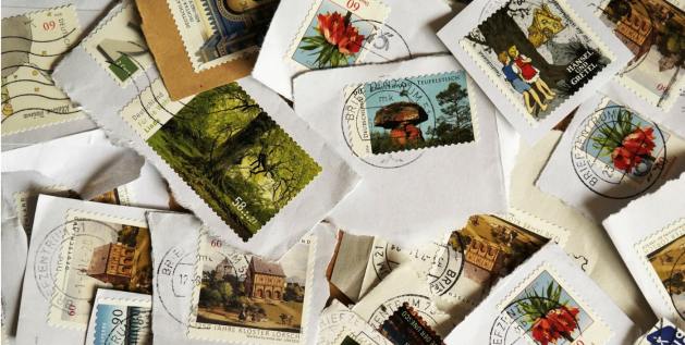 Photograph of stamps on ripped of pieces of envelopes.